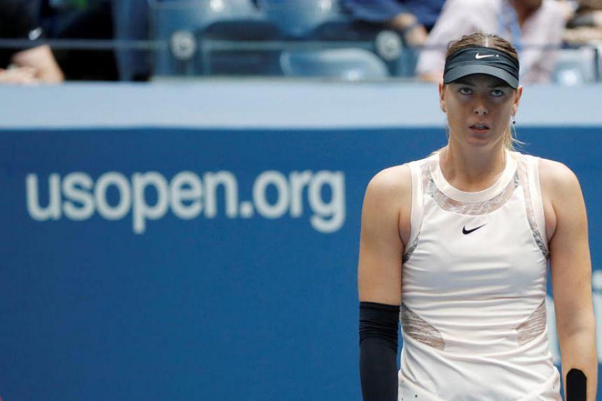 Maria Sharapova of Russia reacts during action against Anastasija Sevastova of Latvia during their fourth round match.