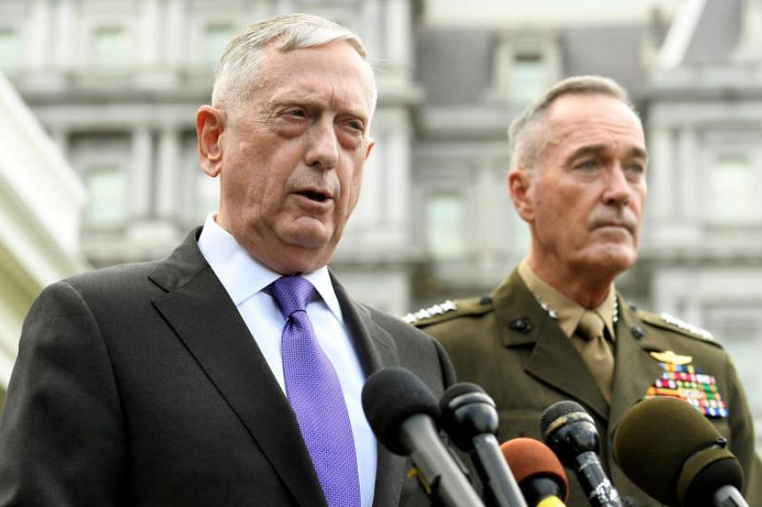 James Mattis (left) makes a statement outside of the White House in response to North Korea's latest nuclear test, as Chairman of the Joint Chiefs of Staff Gen. Joseph Dunford listens on Sept 3, 2017.