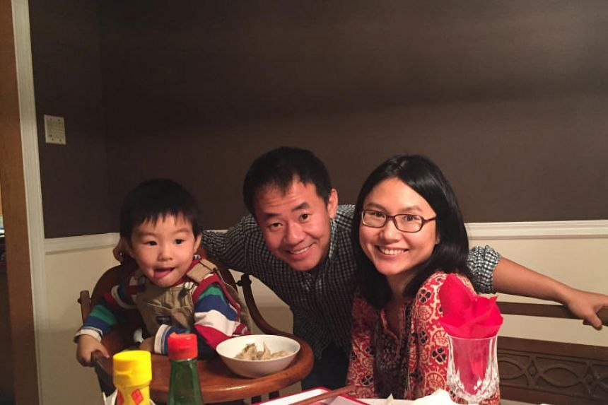 American Xiyue Wang is shown with his wife and son in a family photo released in Princeton, New Jersey, on July 18, 2017.