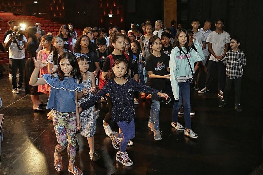 It is the first time Dick Lee is taking on the role of the concert's creative director. Here he is introducing some of the ChildAid performers to fellow performers. The cast and crew got together for the first time for a tour of the Resorts World The