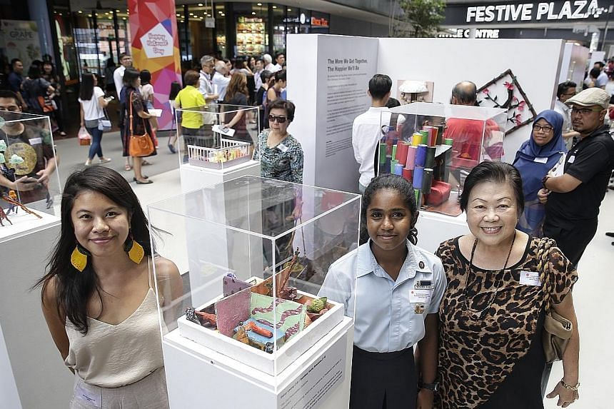"""(From left in picture) Artist Mary Bernadette Lee guided Serangoon Secondary School student Susanna Bombay and retired teacher Daisy Leong in creating """"Our Personalities Outshine"""", an artwork representing what home means to them, currently on display"""