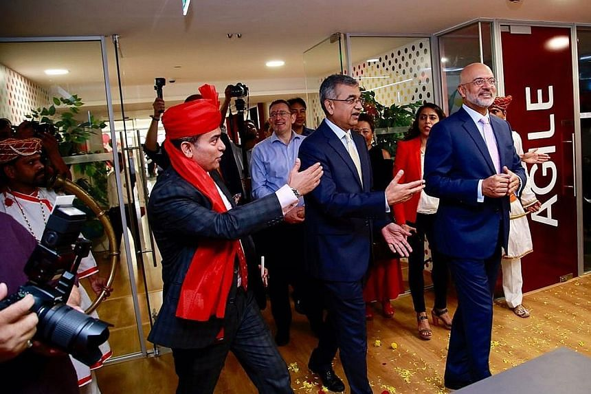"DBS Group chief executive Piyush Gupta (right) at the inauguration of DBS India's new headquarters at the iconic Express Towers in Nariman Point, Mumbai. Spread across 100,000 sq ft over five floors, the open workspace features ""social zones"" and ref"