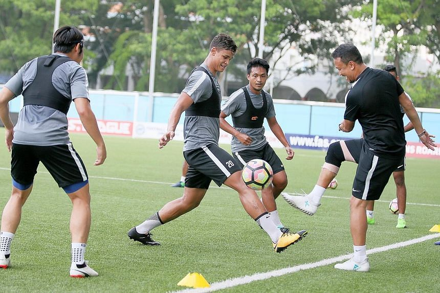 National head coach of youth Fandi Ahmad enjoying training at Jalan Besar with (from left) Ho Wai Loon, Irfan Fandi and Izzdin Shafiq. The Lions are bottom of their Asian Cup qualifying group and badly need a win.