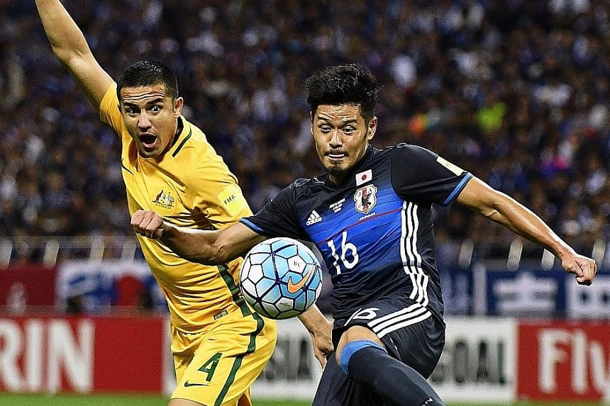 """Tim Cahill, Australia's top scorer with 48 goals, tussling for the ball with Hotaru Yamaguchi of Japan during last Thursday's World Cup qualifier in Saitama, where the home side won 2-0. Cahill has promised that his side will perform """"fearlessly"""" aga"""