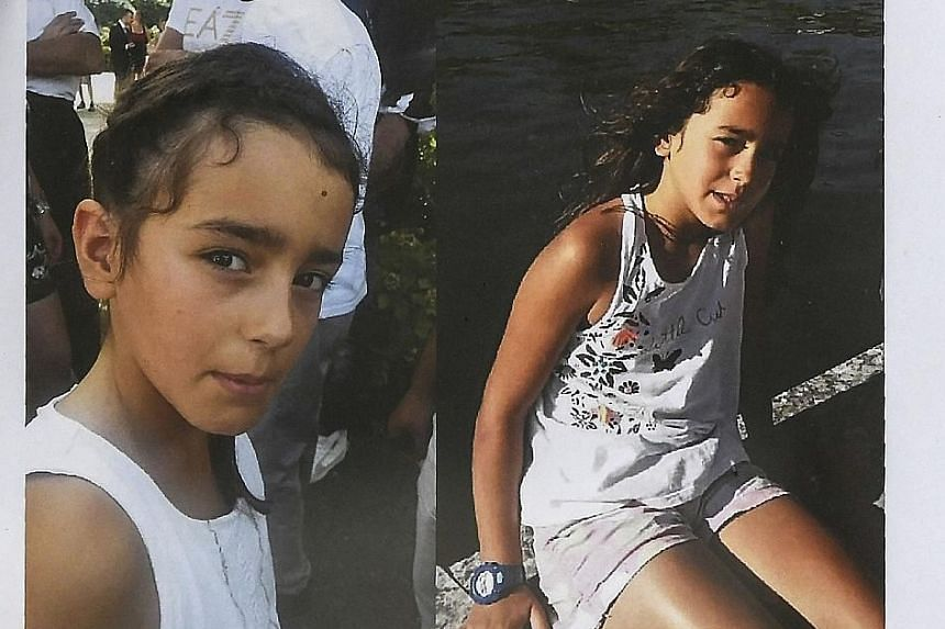 Police officers searching for evidence in Pont-de-Beauvoisin, south-eastern France, last Wednesday, after the disappearance of nine-year-old Maelys de Araujo (below, in an appeal for witnesses poster).