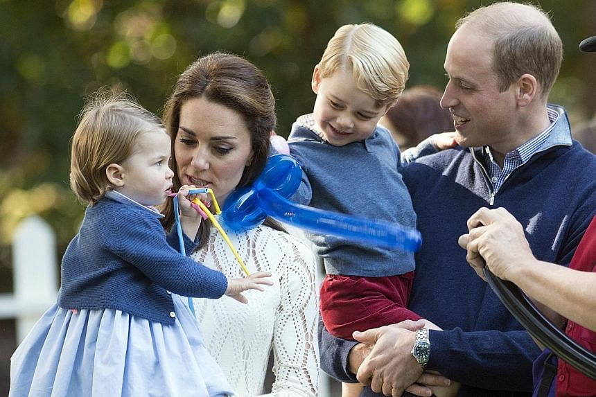 Britain's Prince William and his wife Catherine with their children Princess Charlotte and Prince George.