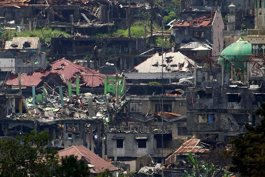 Fighting in Marawi was intense yesterday, with heavy gunfire and explosions ringing out across the once-picturesque lakeside town, the heart of which has been devastated by near-daily government air strikes.