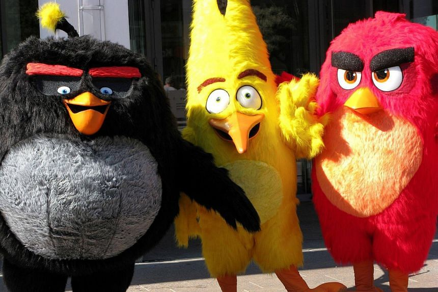 Angry Birds characters Bomb, Chuck and Red are pictured during the premiere in Helsinki, Finland, on May 11, 2016.
