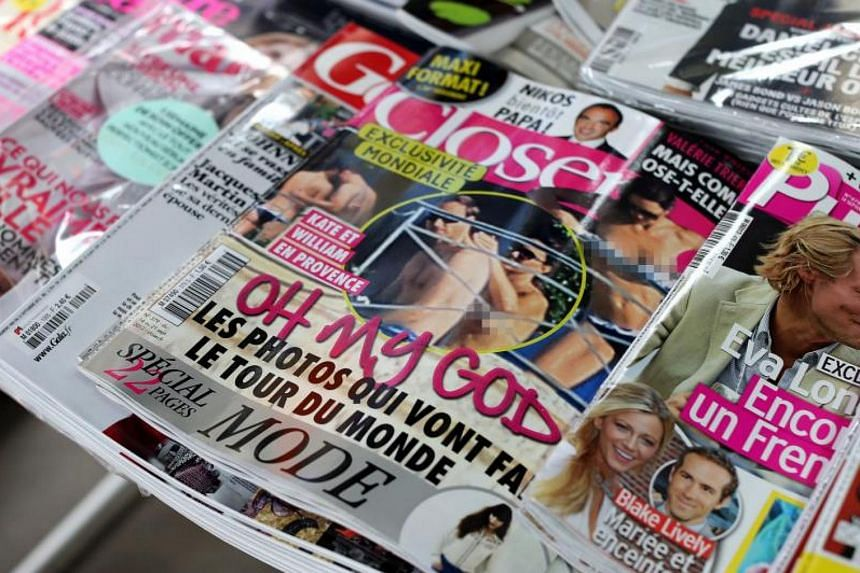 Copies of French celebrity magazine Closer, displayed at a newsstand in Paris on Sept 14, 2012.