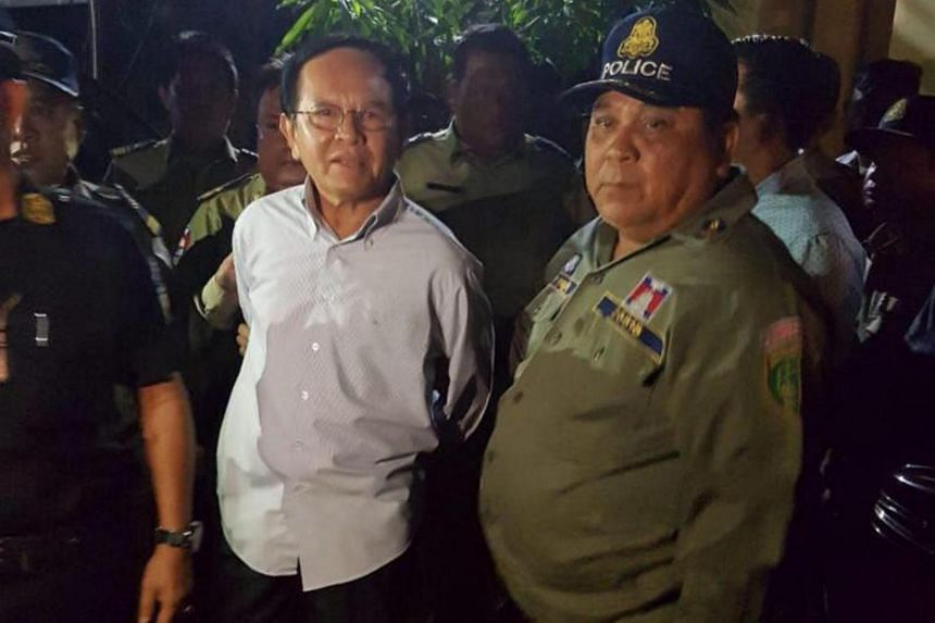 Cambodia's opposition leader Kem Sokha, 64, is detained during a police ride at his home in Phnom Penh, Cambodia on Sep 3, 2017.
