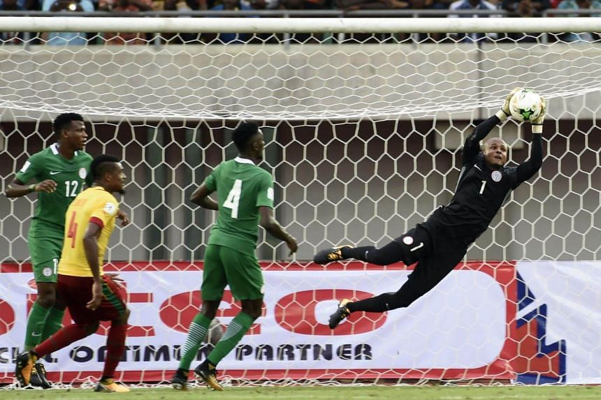 Nigeria's goalkeeper Vincent Ezenwa saves the ball during the 2018 FIFA World Cup qualifying football match between Nigeria and Cameroon at Godswill Akpabio International Stadium in Uyo, southern Nigeria, on Sep 1, 2017.