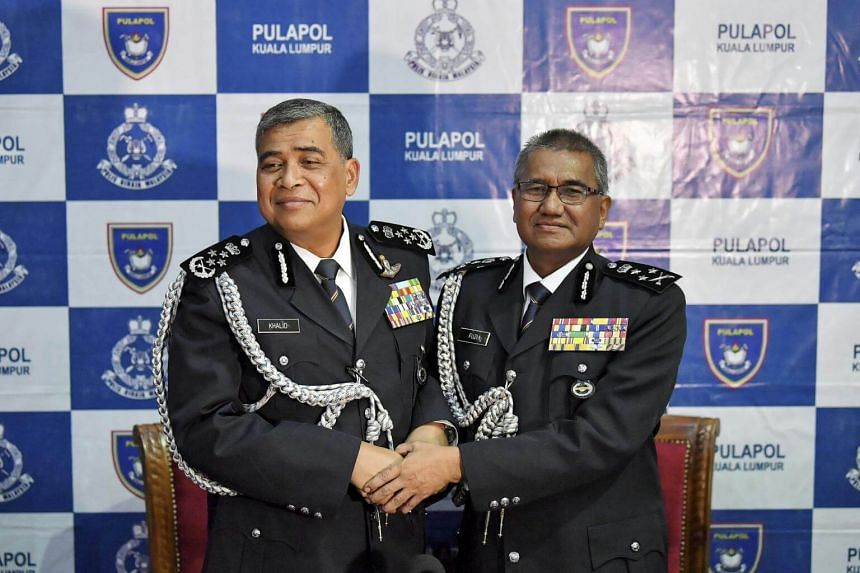 Outgoing Malaysian Inspector General of Police Khalid Abu Bakar (left) with incoming police chief Mohamad Fuzi Harun at the handover ceremony in Kuala Lumpur on Sept 4, 2017.