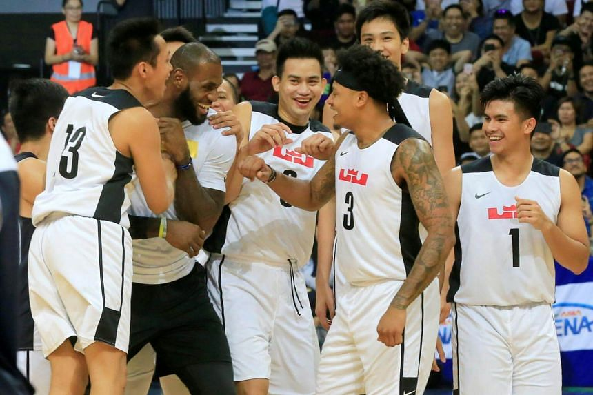 Basketballer LeBron James of Cleveland Cavaliers celebrates with Gilas Pilipinas team after an exhibition game with members of the Philippine Basketball Association (PBA) team, in Manila, Philippines on Sept 2, 2017.
