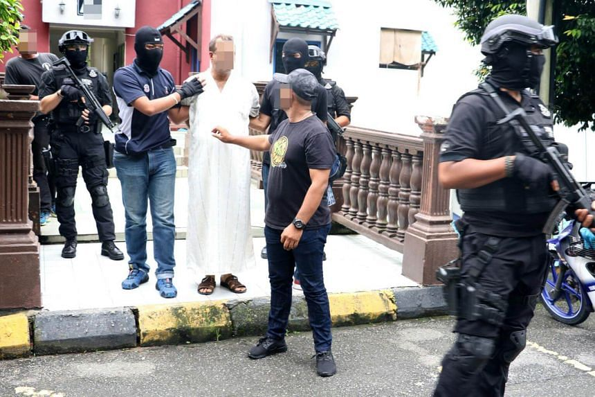 A 25-year-old Bangladeshi teacher, who worked as a temporary teacher at a religious school in Gombak, was handcuffed and escorted out after a premises in Shah Alam was raided on July 4.