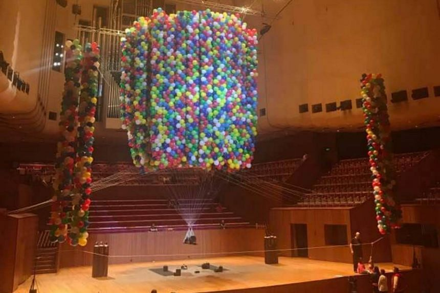 British-Viennese live performance artist Noemi Lakmaier floated for nine hours from 20,000 coloured helium balloons in the largest venue in the Sydney Opera House, the Concert Hall.