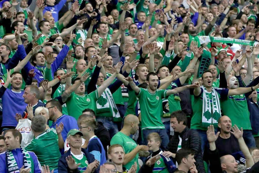 Northern Ireland fans celebrate during injury time of the World Cup 2018 qualification football match between Northern Ireland and Czech Republic at Windsor Park in Belfast, Northern Ireland on Sep 4, 2017.