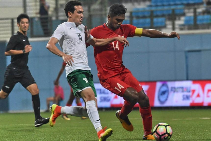 Singapore's Hariss Harun (right) competes for the ball against Turkmenistan's Annayev Myrat during their AFC Asian Cup 2019 Qualifiers Group E football match in Singapore on Sept 5, 2017.