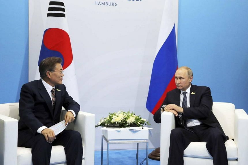 Russia's President Vladimir Putin (right) meets with South Korea's President Moon Jae-in on the sidelines of the G20 summit in Hamburg, Germany on July 7, 2017.