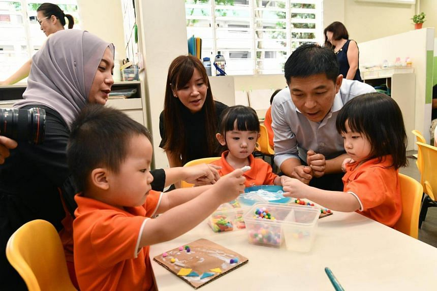 Mr Tan Chuan-Jin interacting with pre-schoolers during his tour to Mr First Skool in Boon Lay Drive on Jan 3, 2017.