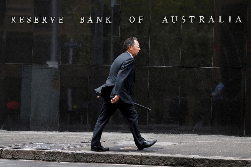 A man walks past the Reserve Bank of Australia in Sydney.