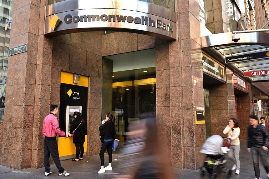 People walk past a Commonwealth Bank branch in the central business district of Sydney, on Aug 8, 2017.