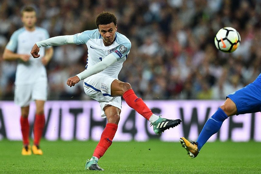 England's midfielder Dele Alli has an unsuccessful shot during the World Cup 2018 qualification football match between England and Slovakia, on Sept 4, 2017.