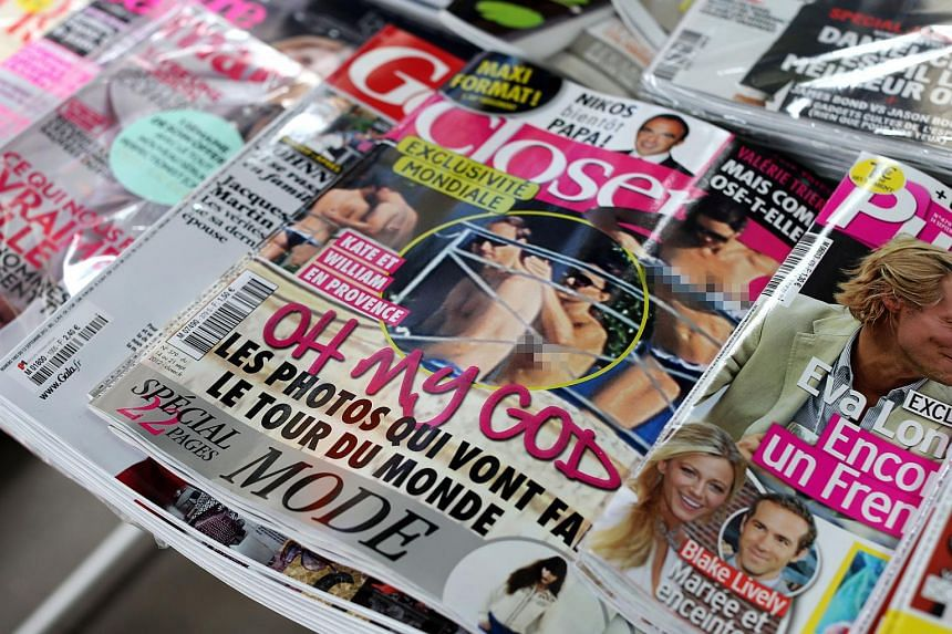 Copies of French celebrity magazine Closer, which published topless pictures of Prince William's wife Kate Middleton, at a newsstand in Paris on Sept 14, 2012.
