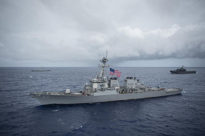 The Arleigh Burke-class guided-missile destroyer USS Benfold (DDG 65) during Exercise Pacific Griffin 2017, off the coast of Guam, on Aug 28, 2017.