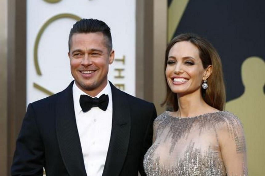 Brad Pitt and Angelina Jolie arrive at the 86th Academy Awards in Hollywood, California, on March 2, 2014.
