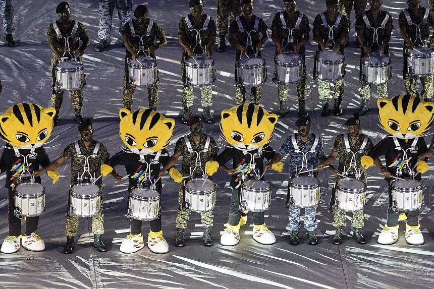 The official mascot of the SEA Games, Rimau, takes part in the closing ceremony of the SEA Games 2017 at the Bukit Jalil National Stadium in Kuala Lumpur, Malaysia, on Aug 30, 2017.