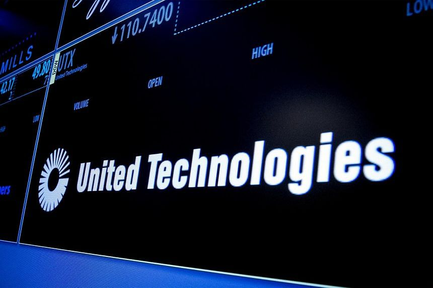 The ticker symbol for United Technologies is displayed on a screen on the floor of the New York Stock Exchange on July 20, 2015.