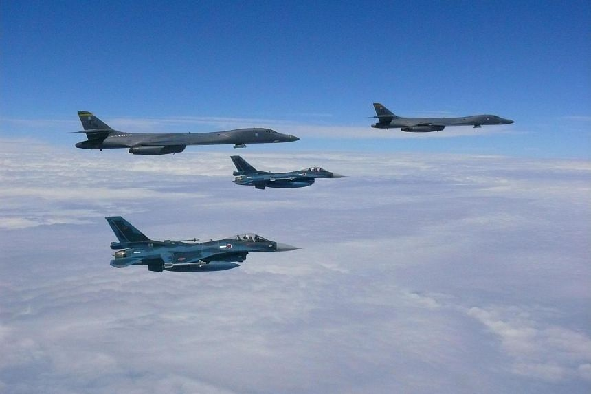 This image obtained from the US Air Force shows two Air Force B-1B Lancers (top left and right) flying from Andersen Air Force Base, Guam, for a 10-hour mission, flying in the vicinity of Kyushu, Japan, the East China Sea, and the Korean peninsula, o