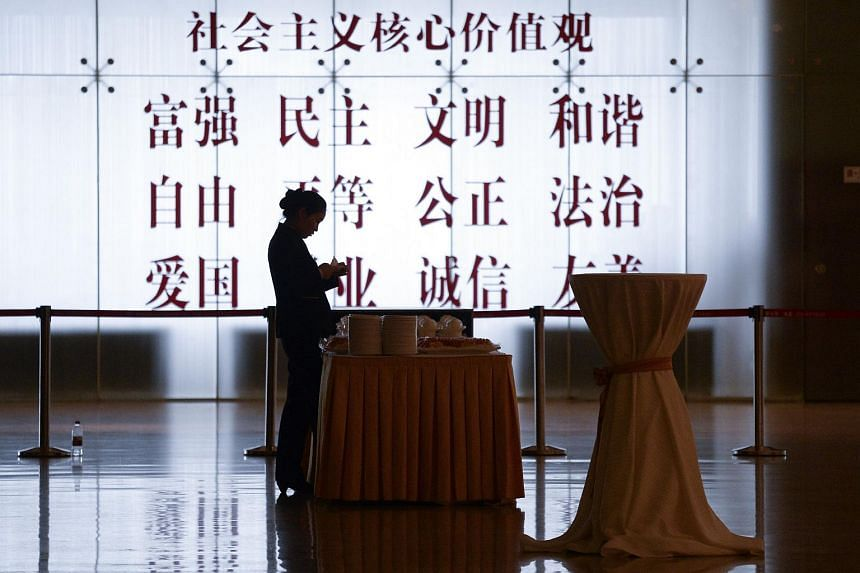 A waitress prepares for the Clean Energy Ministerial international forum at China National Convention Center on June 7, 2017.