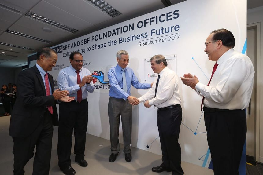 (From left) Former Singapore Business Federation chairman Stephen Lee, Minister of Trade and Industry (Industry) S. Iswaran, PM Lee Hsien Loong, SBF chairman Teo Siong Seng and Mr Tony Chew, also former SBF chairman, at the official opening of SBF an