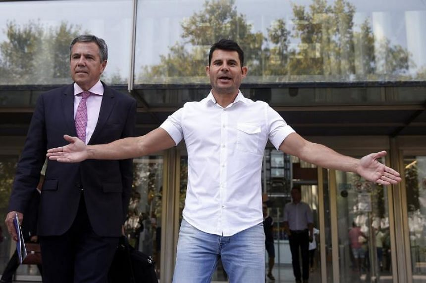 Javier Sanchez Santos (right) arrives at court in order to present the paternity suit in Valencia, Spain, on Sept 4, 2017.