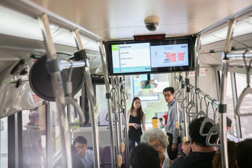 Passengers ride a single-deck bus service 106, operated by Tower Transit between Bukit Batok and Shenton Way.