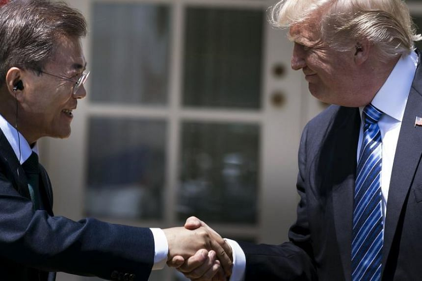 South Korea's President Moon Jae-in and US President Donald Trump shake hands at the White House on June 30, 2017.