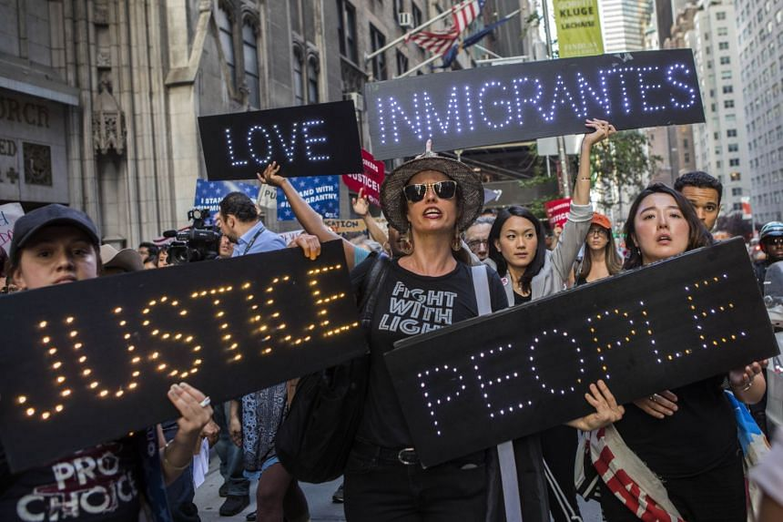 People protest in support of Deferred Action for Childhood Arrivals recipients in New York, Aug 30, 2017.