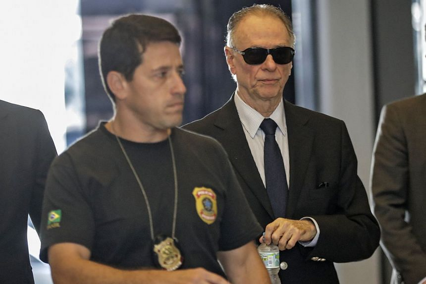 Nuzman (right) arrives at the headquarters of the Federal Police to give a statement, Sept 5, 2017.