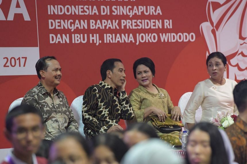 President Joko Widodo and his wife on stage after the singing of the national anthem.