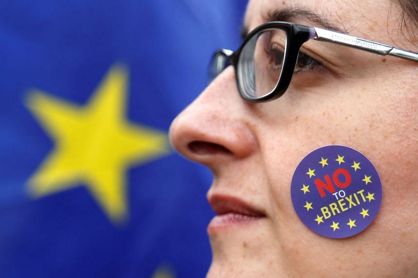 An anti-Brexit protester campaigns near EU institutions in Brussels, Belgium, Sept 5, 2017.