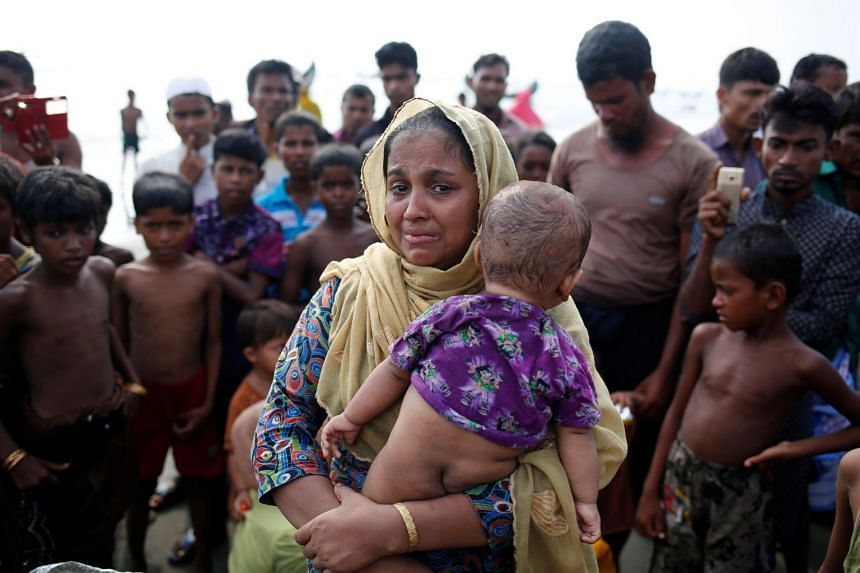 A Rohinkgya refugee cries after crossing the Bangladesh-Myanmar border, Sept 5, 2017.