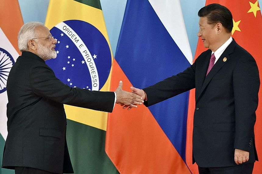 Indian Prime Minister Narendra Modi and Chinese President Xi Jinping at the summit in Xiamen on Monday.