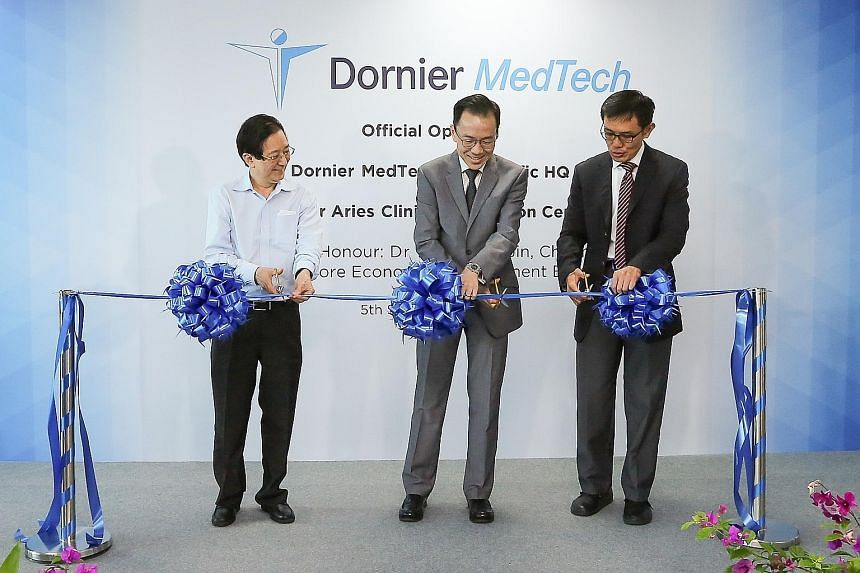(From far left) Accuron MedTech chairman Philip Yeo, EDB chairman Beh Swan Gin and Mr Abel Ang, CEO of Dornier MedTech and group CEO of Accuron MedTech, officially opening Dornier MedTech's Asia-Pacific Headquarters and Global Clinical Innovation Cen