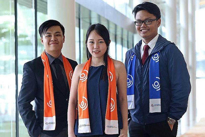 Newly appointed Singapore Workplace Safety and Health Youth Champions (from far left) Clifford Kwok, 18, Rebekah Peh, 24, and Raden Wirano Gatot, 18. They will be trained in safety and health concepts which they can impart to their peers.