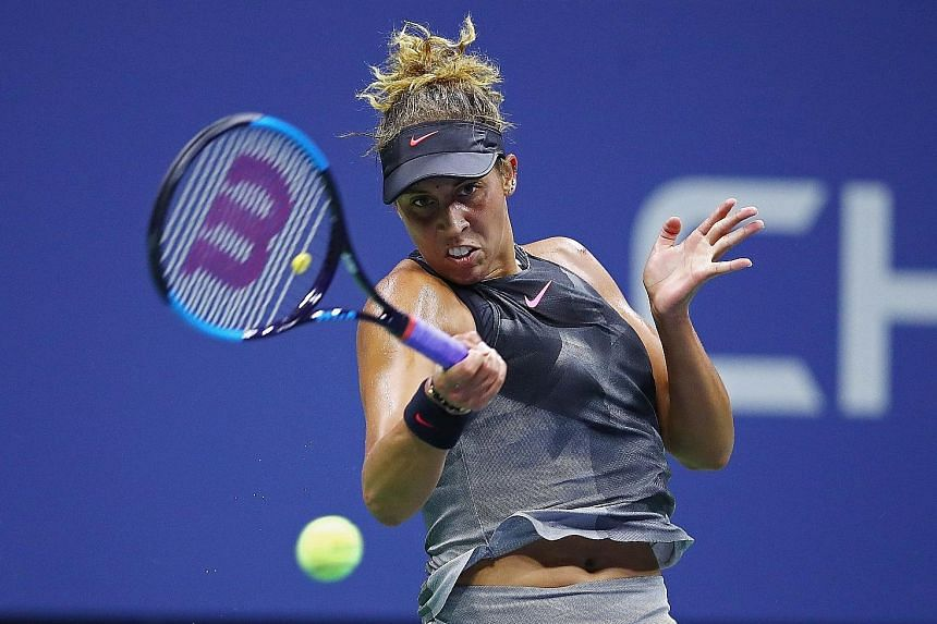 Madison Keys of the United States whips a forehand during her 7-6 (7-2), 1-6, 6-4 win against Elina Svitolina of Ukraine in the fourth round. There are four American women in the quarter-finals at Flushing Meadows for the first time since 2002.
