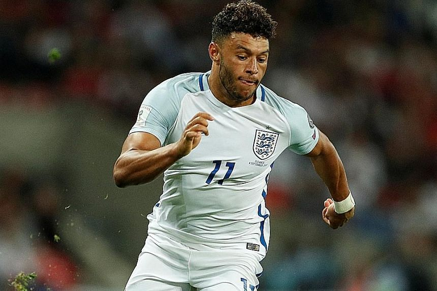 England midfielder Alex Oxlade-Chamberlain driving at Slovakia's defence during their World Cup qualifier on Monday. He chose to move to Liverpool instead of Chelsea, over Antonio Conte's plans to play him at wing-back.