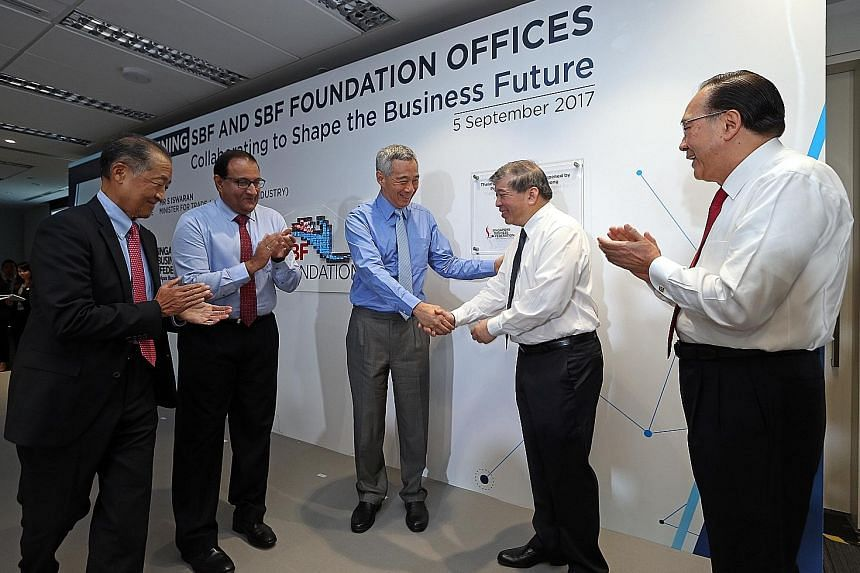 (From left) Past SBF chairman Stephen Lee, Minister for Trade and Industry (Industry) S. Iswaran, Prime Minister Lee Hsien Loong, SBF chairman Teo Siong Seng and past SBF chairman Tony Chew at the official opening of SBF Centre in Robinson Road yeste