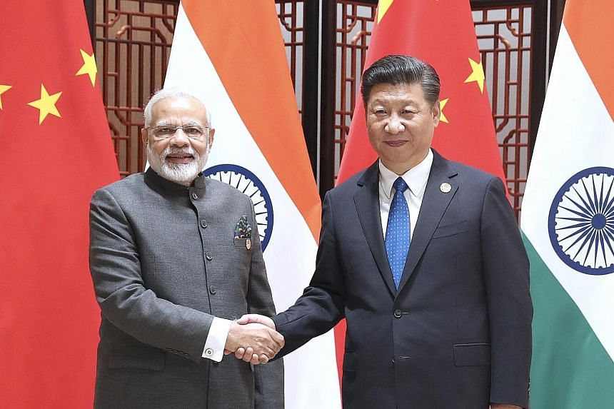China's President Xi Jinping and India's Prime Minister Narendra Modi held talks at the 9th Brics summit in Xiamen yesterday.