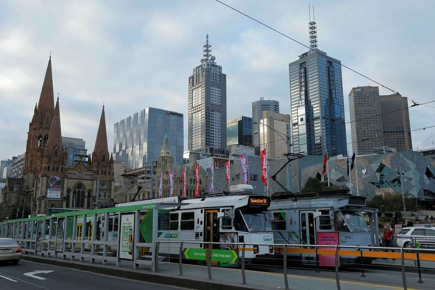 Trams pass by Melbourne's city skyline in Australia's second-largest city, on June 13, 2017.